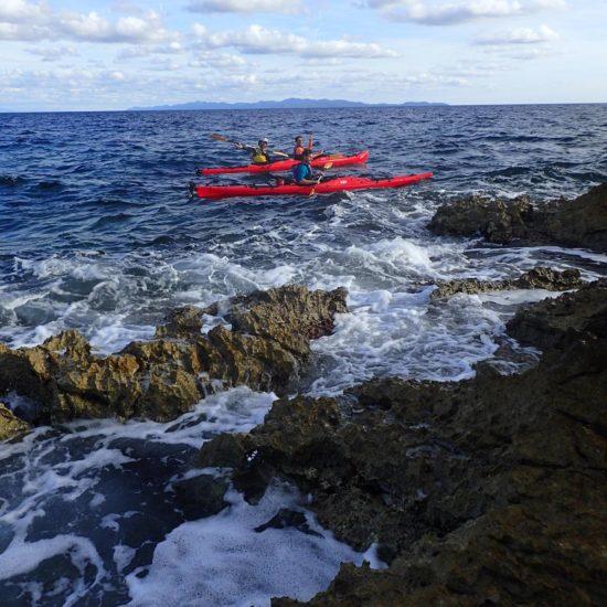 people in kayaks near seacoast in Lumbarda