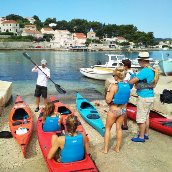 coach teaching guests how to paddle