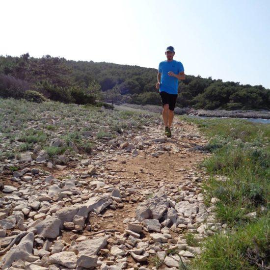 man on trail running in Lumbarda Korcula