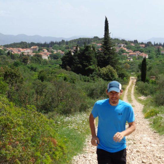 man on trail running in Zrnovo Korcula