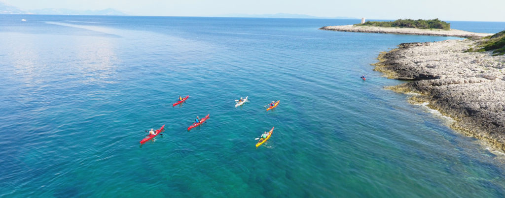 people in kayaks drone photo